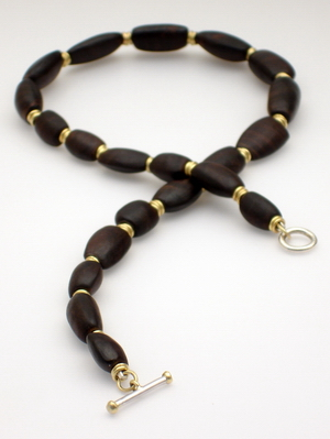 African blackwood and 18ct gold necklace.